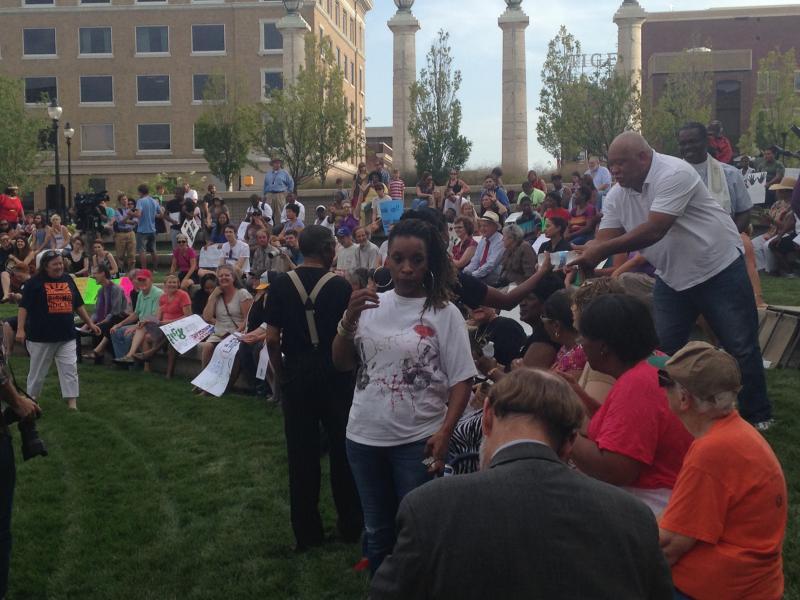 Demonstrators participate in chants