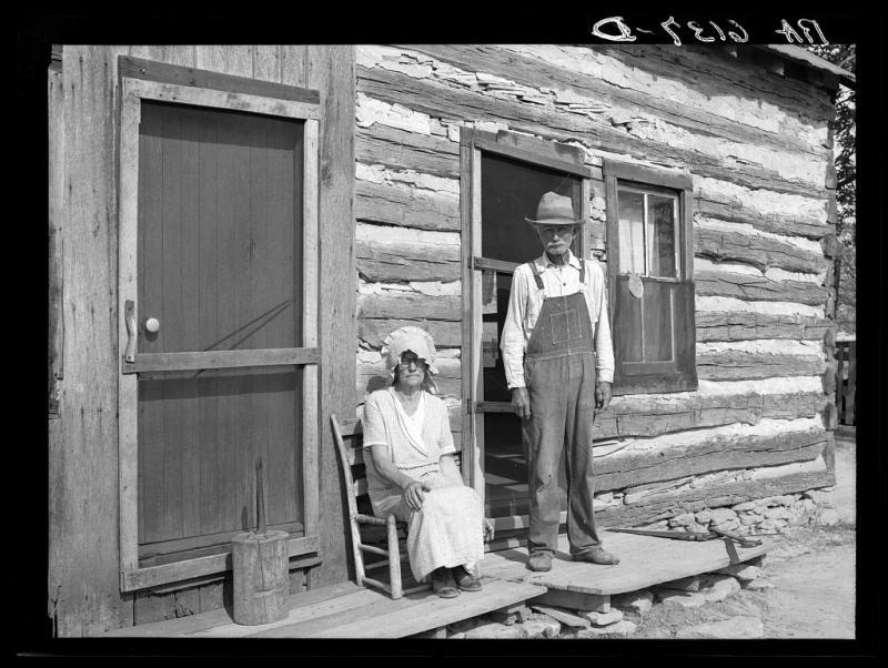 Nick Phillips, eighty-one years old with wife in front of house. Ashland, Missouri. Missouri game and arboretum project. Columbia, Mo. (May 1936)