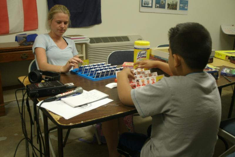 University of Missouri junior Kate Landmann plays Guess Who? on a recent Monday with Angelo Ruitaga.