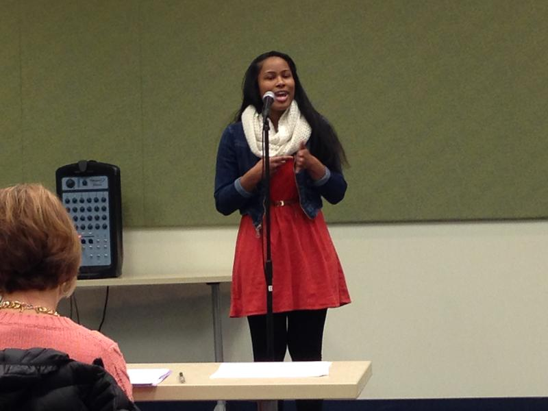 Shakira Cross recites a poem at the regional Poetry Out Loud competition.