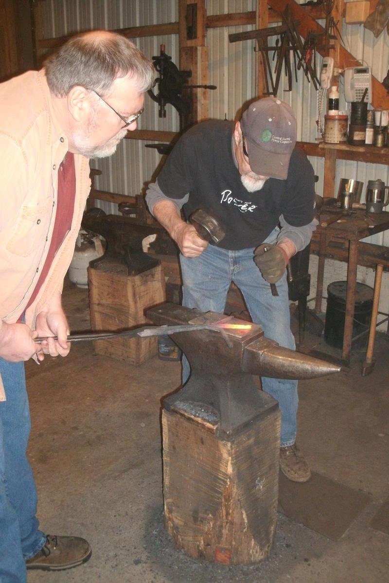 Doug Knight at left is an apprentice to master blacksmith Bernard Tappel in the Missouri Folk Arts Program's Traditional Arts Apprentice Program. He is working to be a master blacksmith himself.