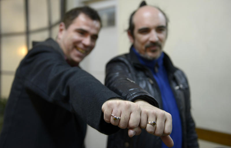 two men show off their wedding rings after registering to marry in montevideo uruguay aug 5 2013 - Gay Mens Wedding Rings
