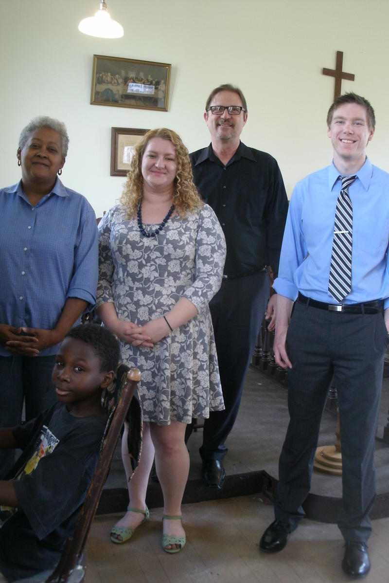 Sandra Enyard (at left) recently gave a tour of Glasgow's Campbell Chapel AME Church for her grandon Javon (seated) and Missouri Preservation's Administrator Katie Graebe, Executive Director Bill Hart and intern Michael Parker