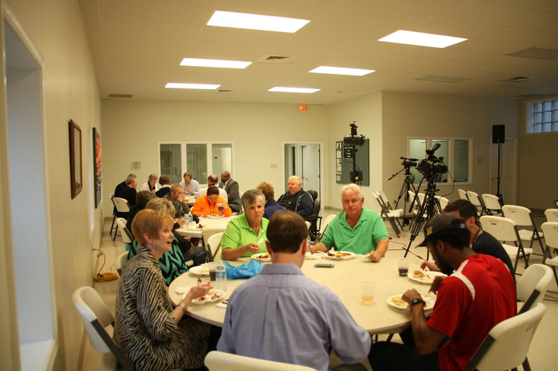 Attendees discuss rural economics and health care access over dinner at the First Presbyterian Church Activity Center, in Kennett, Mo.