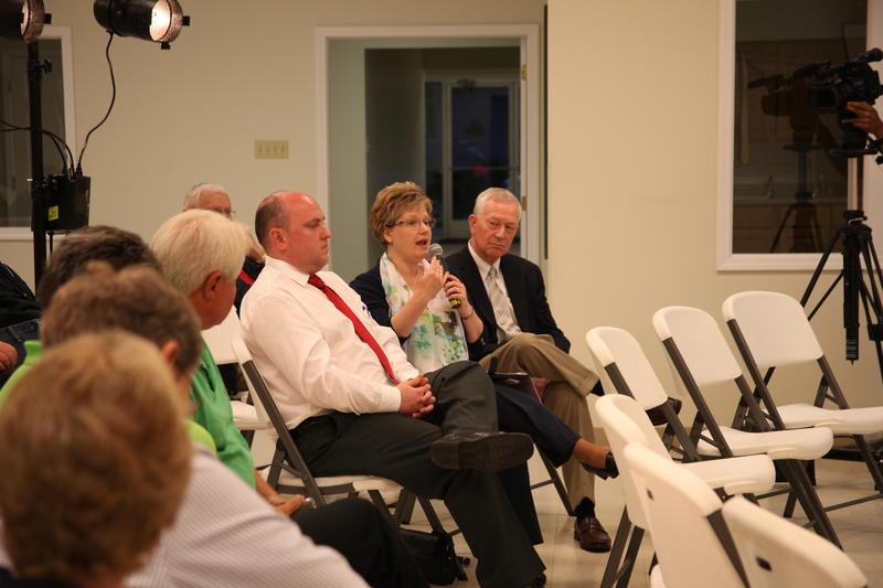 Rep. Tila Hubrecht, R-Dexter, (center) asks a question. Rep. Andrew McDaniel, R-Deering, (left) was also in attendance.