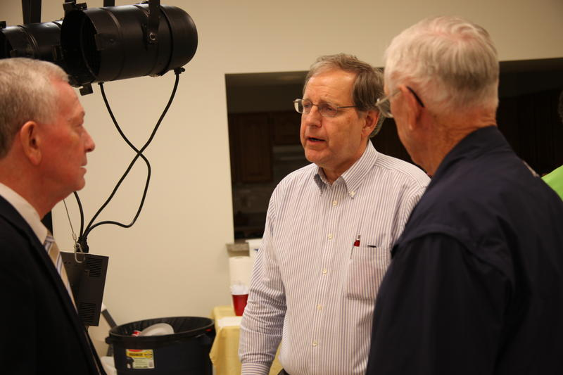 Jim Grebing (center), Director of Economic Development in Kennett, Mo., speaks with other attendees after the event.