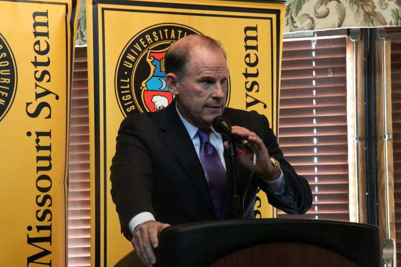 Wolfe delivering his statement of resignation Monday morning.