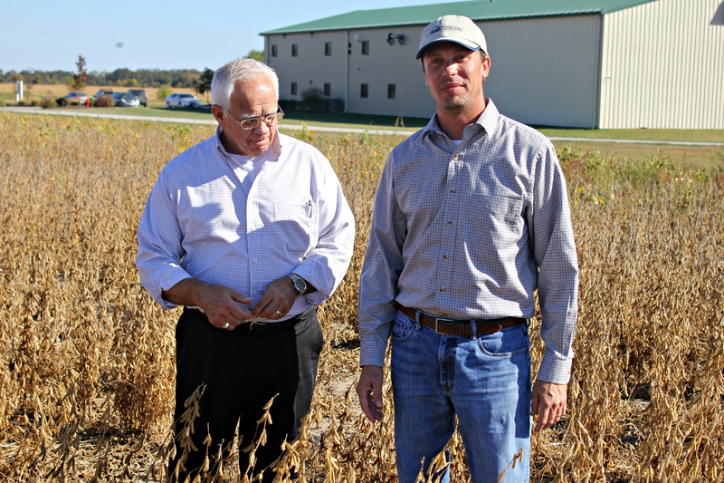 University of Missouri soybean researcher Andrew Scaboo, right, and director of Business Development for Missouri Soybean Association Tony Stafford check on test plots of soybean plants using Roundup Ready technology.