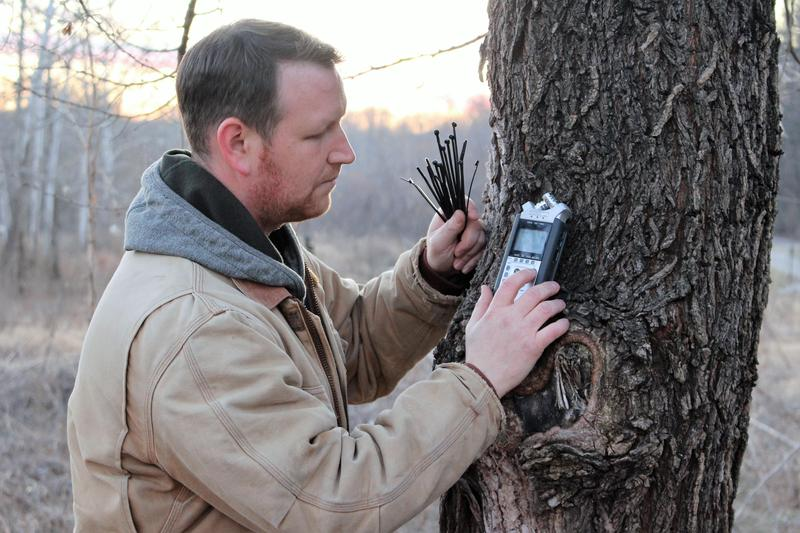 Christopher Bobryk deploying a recorder in the field. Bobryk works in the emerging area of soundscape ecology.