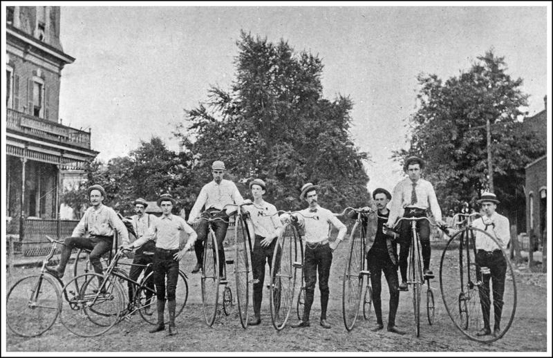 Nine members of a local bicycle club pose for a picture. The image was among several hundred that were recently donated to the Boone County Historical Society.