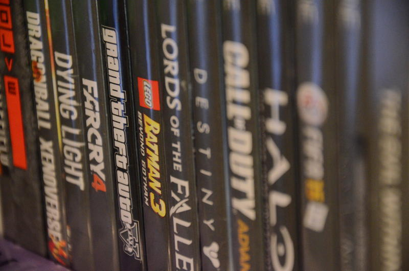 Garrett Bullock's video game collection is lined up on a shelf in his bedroom on Monday, April 11, 2016. Bullock is especially partial to the Halo games.