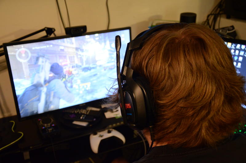 Garrett Bullock plays 'Tom Clancy's The Division' video game on Monday, April 11, 2016. Bullock participates in 24 hour gaming marathons to raise money for MU Women's and Children's Hospital.