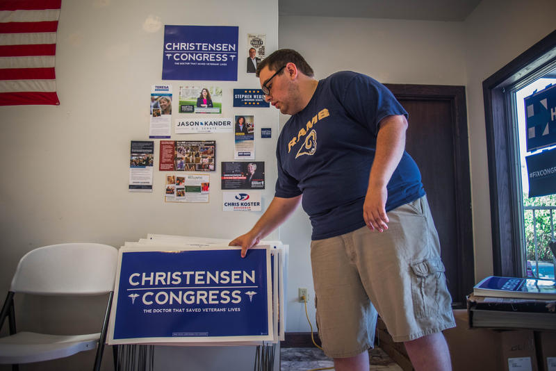 Doug Witt, deputy campaign manager for the Christensen for Congress campaign, stacks yard signs promoting Gordon Christensen, a Democratic candidate running for the 4th Congressional District at Boone County Democratic Party's office in Columbia, Missouri