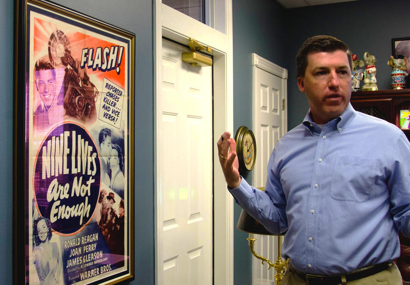 "James Harris, a political strategist and the founder of J. Harris Company, explains how he found his poster of ""Nine Lives Are Not Enough,"" a movie starring President Ronald Reagan, at his office in Jefferson City, Missouri, on Tuesday, Oct. 18, 2016. Har"