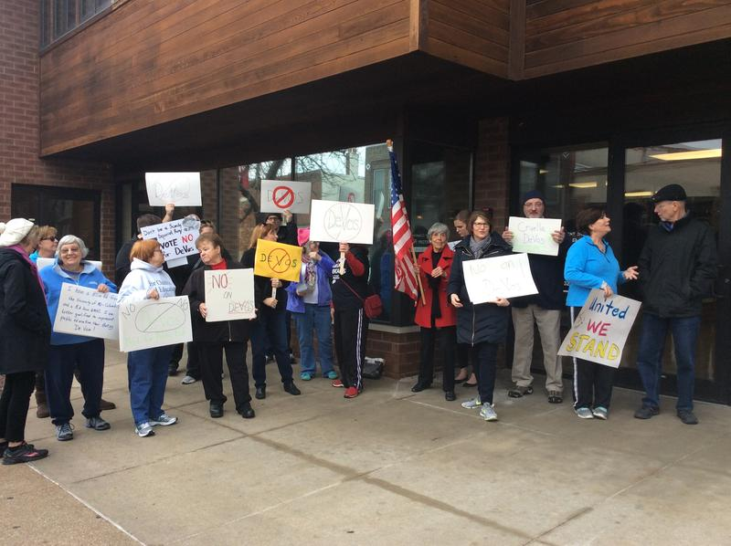 Teachers and community members gathered outside of Sen. Roy Blunt's office Monday, Feb. 6, 2017 in downtown Columbia.