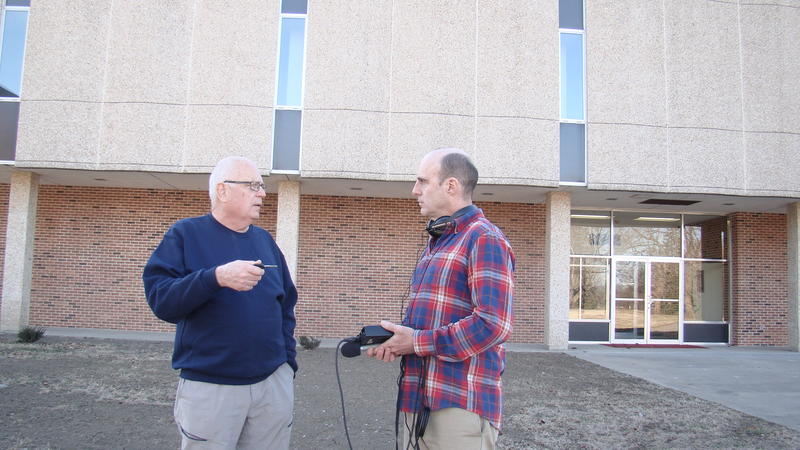 KBIA's Trevor Harris talks with Robert Pearson, a Tarkio resident who volunteers to help prepare the campus for new students this fall.