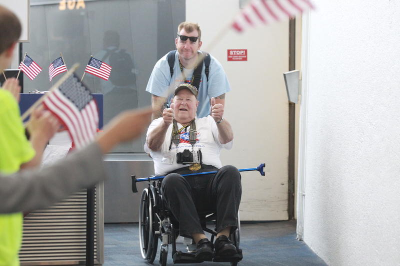 A veteran and his guardian on Central Missouri Honor Flight #47 exit the jetway at Washington's Reagan International Airport last Wednesday.