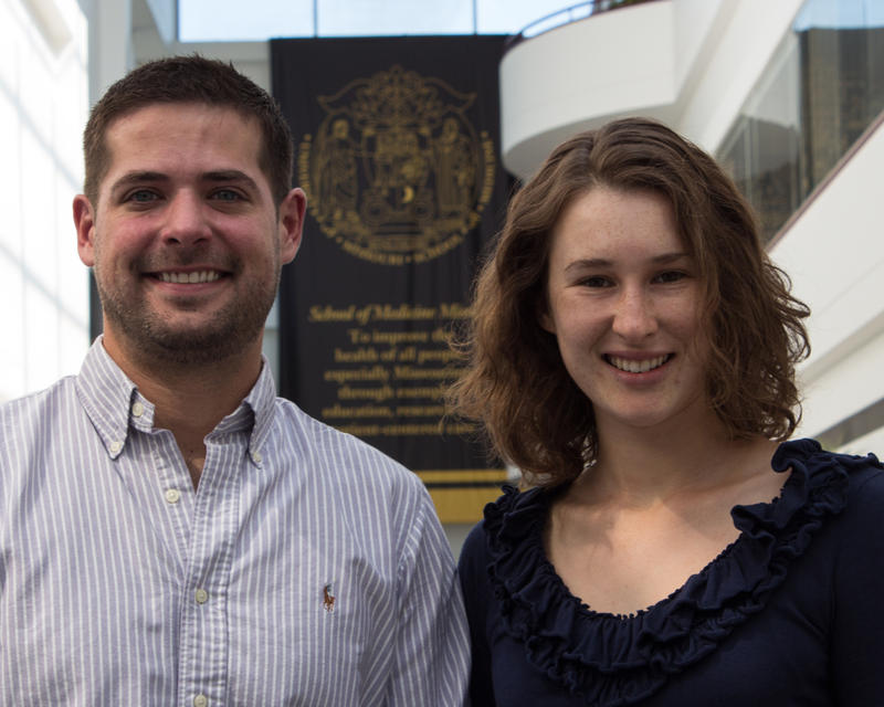 Sam McMillen, left, stands next to Elizabeth Modde, right, in the foyer of the University of Missouri Medical School