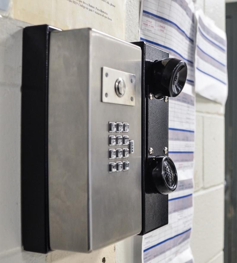 Jail phone systems across Missouri, like the one in the Callaway County Jail shown here, are provided through contracts with private companies like Securus.