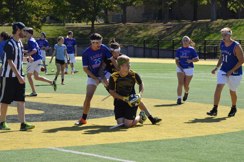 Players from both teams battle over the ball at last Saturday's quidditch match.