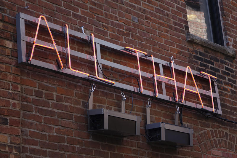 "Artist Alicia Eggert's sign switches between ""All that is real is possible"" and ""All that is possible is real"" in Alley A at True/False Film Festival."