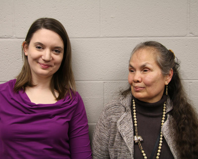 Grethen Maune, left, wears a bright purple shirt and smiles into the camera. DeAnna Quietwater Noriega, right, wears a brown knit cardigan and smiles.