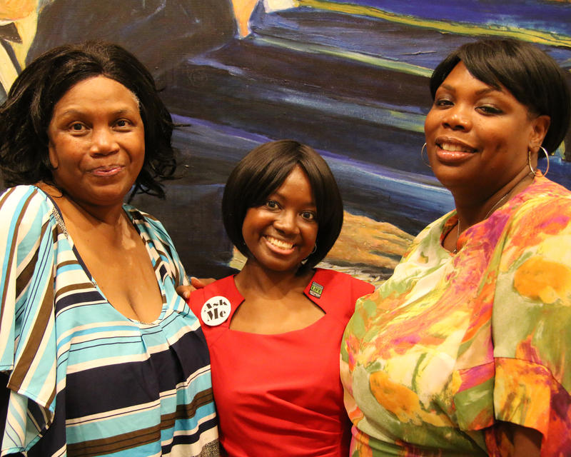 Christina Jackson, center, stands flanked by her mother, Paula Jackson, left, and her older sister, Andrea Jackson, right.