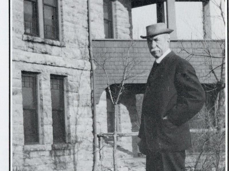 John H. Bothwell in front of the kitchen porch at the Bothwell Lodge in Sedalia, Missouri.