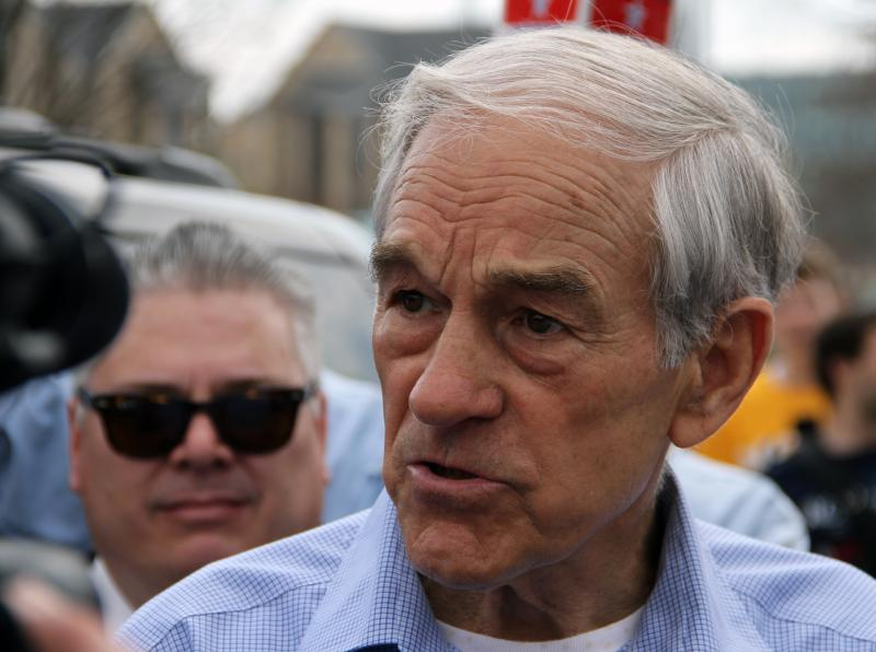 Presidential candidate speaks to reporters after giving a speech on the south end of the David R. Francis Quadrangle on the University of Missouri campus on Thursday, March 15, 2012.