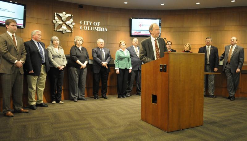 Columbia Mayor Bob McDavid announces the Atlanta flight at a press conference Friday, March 2, 2012