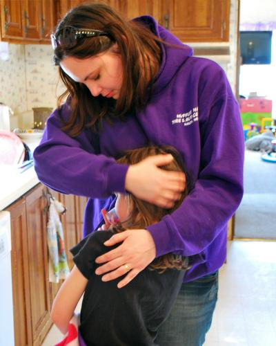 Chandra Grawe, 32, of Macon, Mo., hugs her five-year-old daughter Veronica. Grawe had both of her children at a hospital in Moberly, a 30-minute drive from Macon.