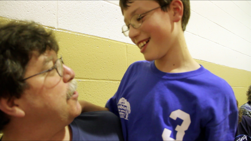 Josh Wilson puts his arm around his father, Dan, after his team captured the gold medal at Columbia Parks and Recreation's Special Olympics basketball tournament on Tuesday, March 19, 2012, in Columbia, Mo.