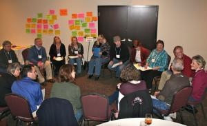 A small group gets the discussion rolling at the Big Rural Brainstorm in Newton, Kan.