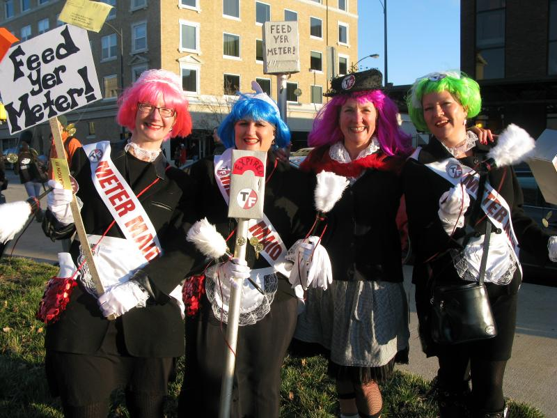 From left to right: Ann Breidenbach, Jacquelyn Sandone, Barbie Reid and Elizabeth Bergman pose for a picture before the March March. The four friends dressed as meter maids.