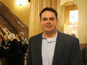 T.J. Curtis, a western Kansas farmer, traveled to the state capitol in support of a bill that would establish a state-sanctioned program to assist undocumented workers gets jobs.