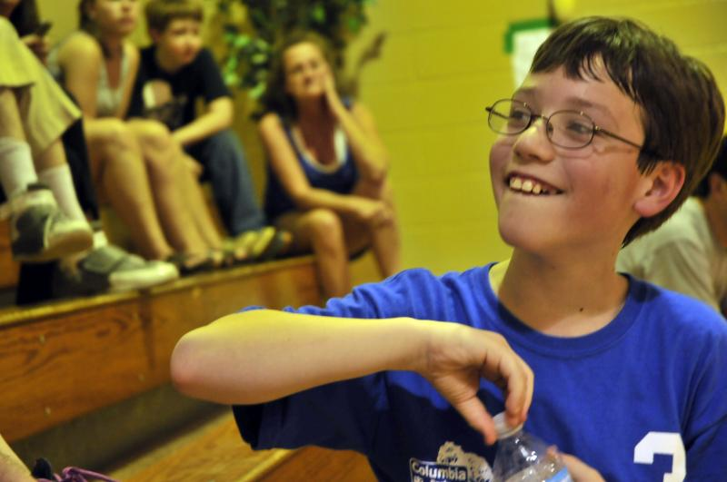 Josh Wilson, 11, takes a water break in between his Special Olympics basketball tournament games on Tuesday, March 19, 2012, in Columbia, Mo. Josh, who has autism, competes with his brother, Ryan, 18. Josh's team won the gold medal in their division.
