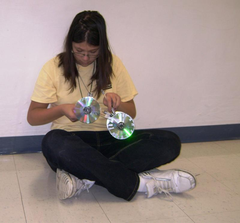 Ninth grader Helen Temporal works on her mouse trap car outside her industrial tech. classroom at Oakland Junior High.