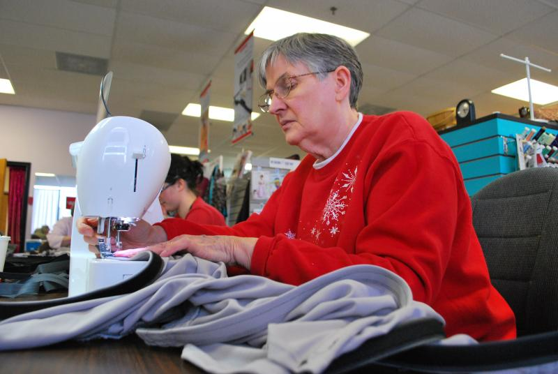 Sewing club member Jeannie Sanchez, of Columbia, sews a velcro strip into a pair of athletic shorts at Zede's Sewing Shop on Friday, March 2, 2012. The shorts will be sent to wounded veterans at Walter Reed Medical Center in Bethesda, Md.