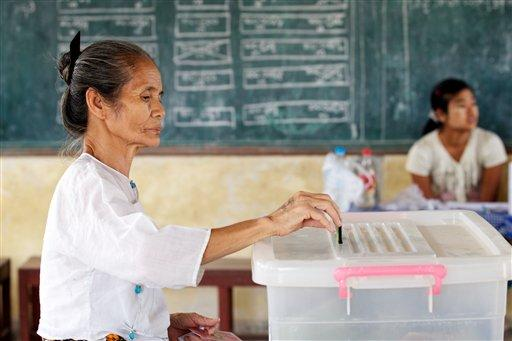 A woman places her vote during elections held earlier this month in Myanmar.