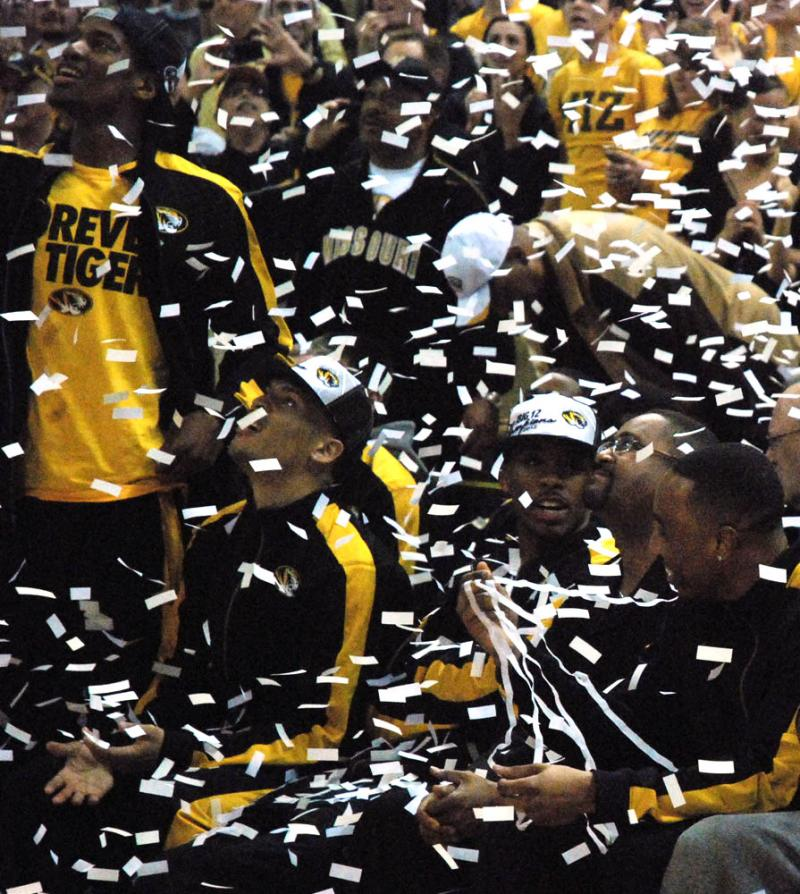 (From left to right) Kim English, Mike Dixon, Marcus Denmon, coach Haith and Matt Pressey are showered with confetti when it's announced the Tigers will be a No. 2 seed in the West region.