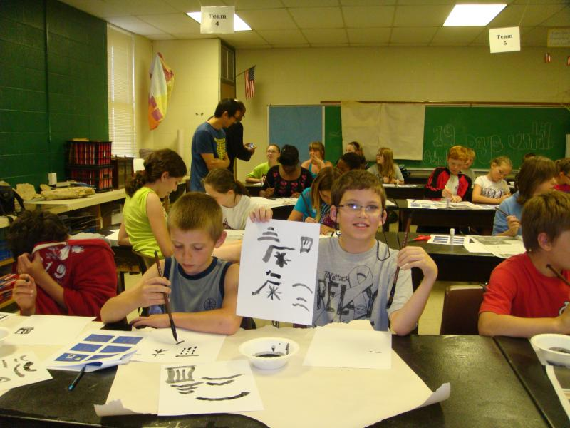 Students at North Callaway School District write Chinese characters by using a traditional brush pen. April 25, 2012.