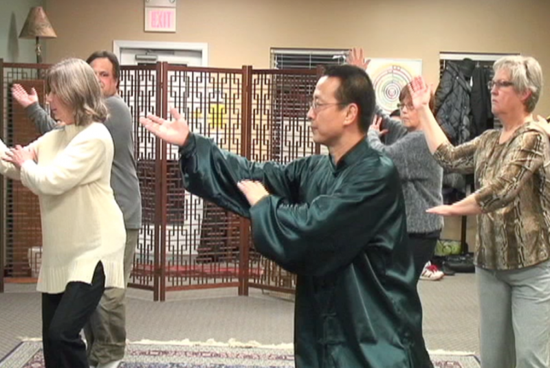 Arthur Du leads a group in Tai Chi practice.