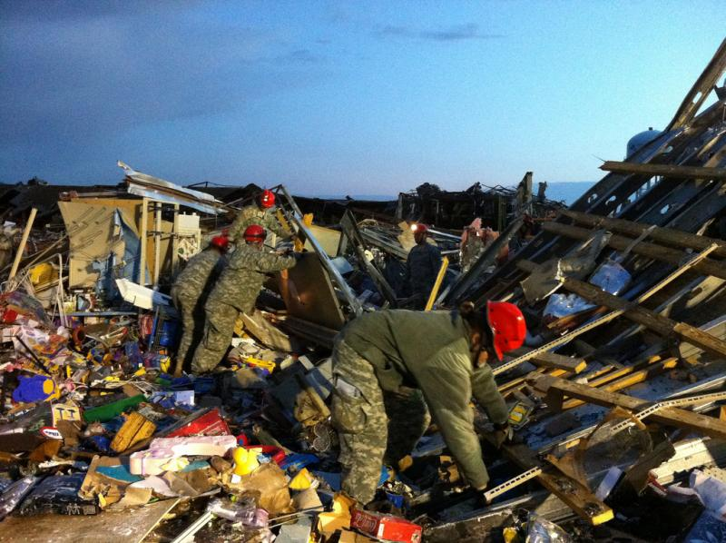 Missouri National Guard Soldiers with the 117th Engineer Team work search and rescue missions in Joplin, Mo., just hours after a deadly tornado passed through.