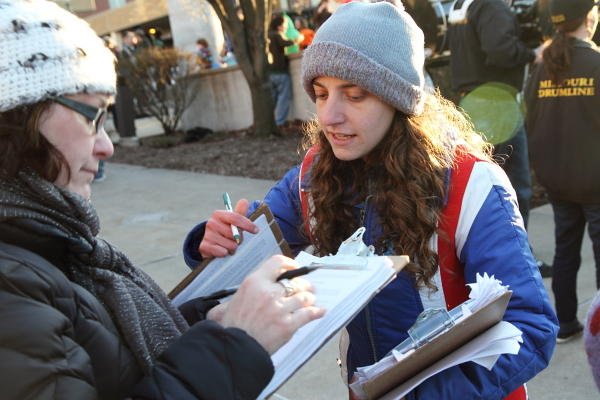 Rachel English, with Grass Roots Organizing, gathers signatures in Columbia for the 36 percent cap.