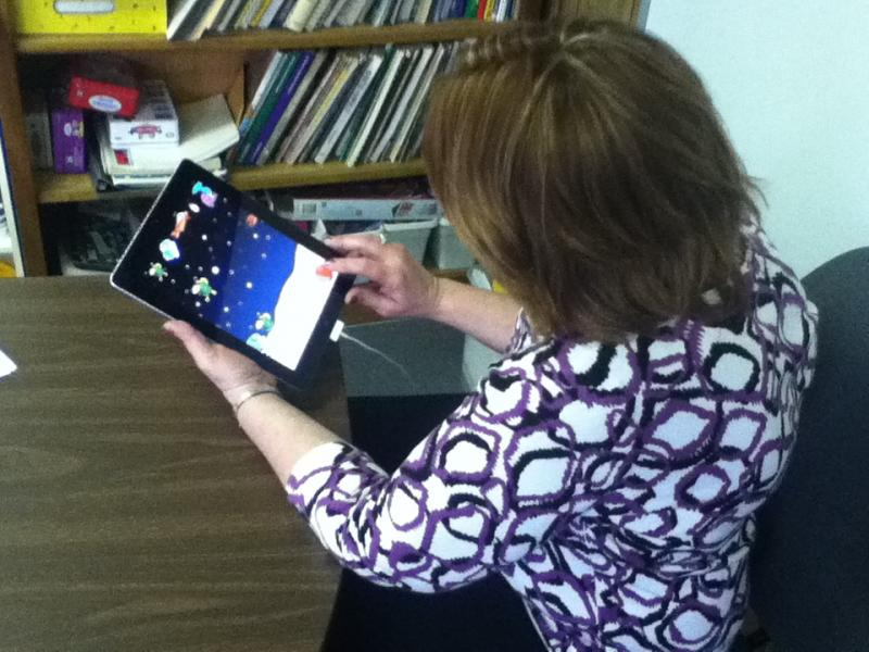 Teacher Denise Lasley uses an iPad at Benton Elementary School.