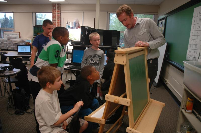 Jason Aubrey works with students in the video game club at Benton Elementary in Columbia, MO