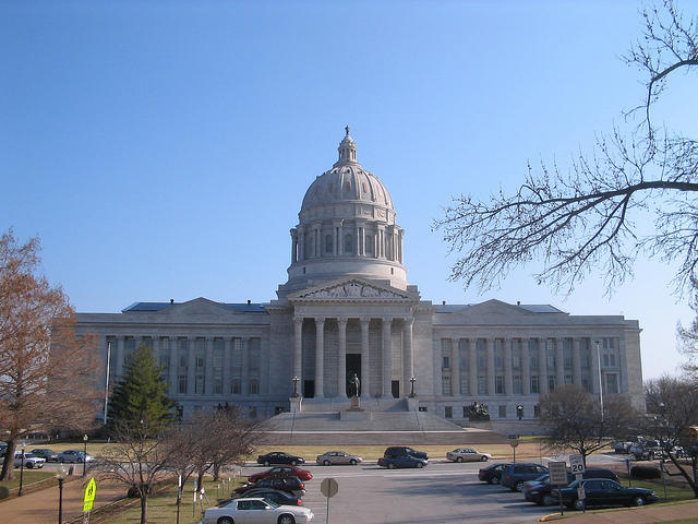 Missouri governor signs jobs bill, cancels Europe trade trip