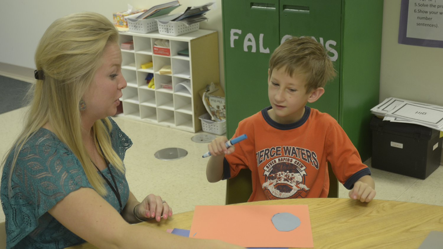 Nathaniel Wright works on a craft at Blair Oaks Elementary School right  outside of Jefferson City. His mother said Nathaniel's social skills have  improved ...