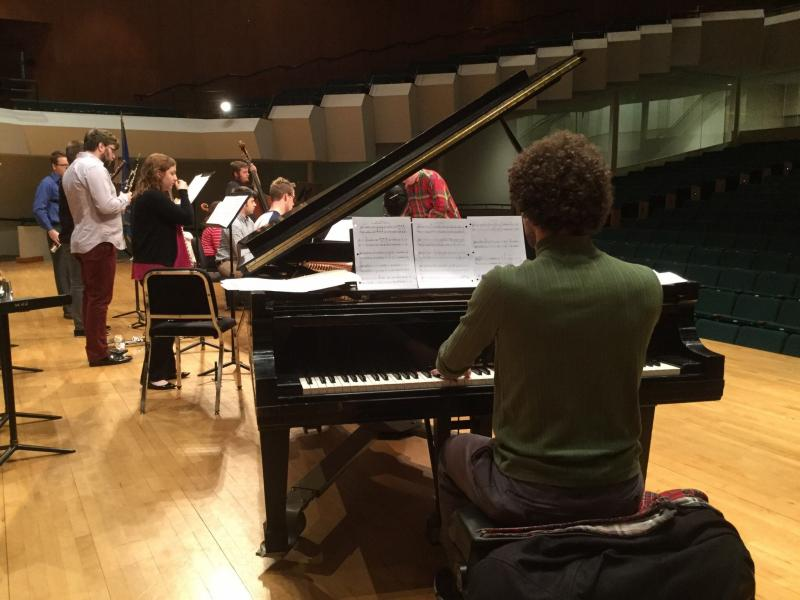 Henry Stewart, seated at piano, rehearses with the Exit 128 Chamber Orchestra at the University of Oklahoma.