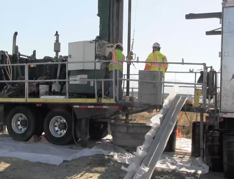 Workers drill into airport property to search for the source of TCE that's showing up in neighboring residential wells.